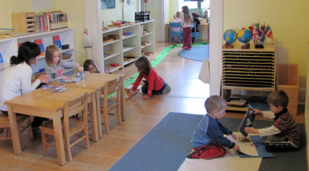 Children working at their own pace in a Montessori Classroom